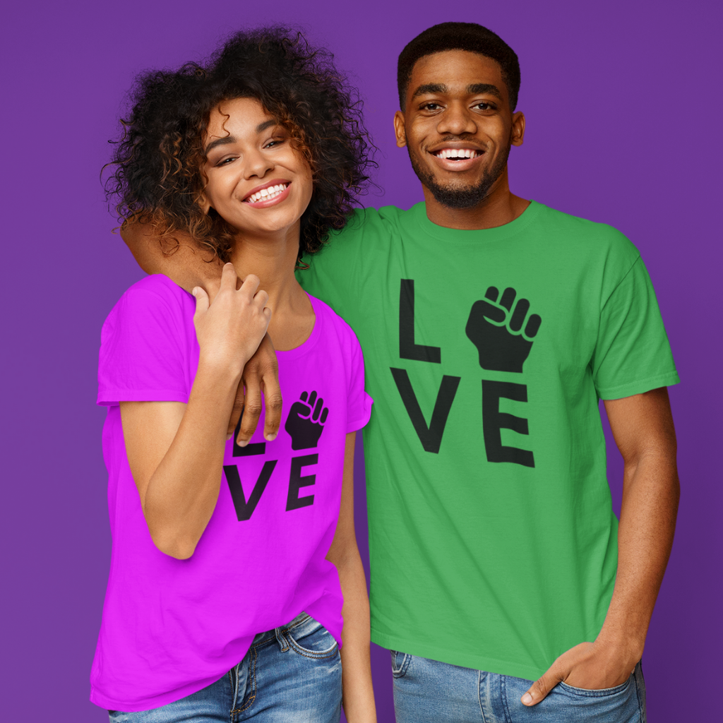 couple in black power fist shirt