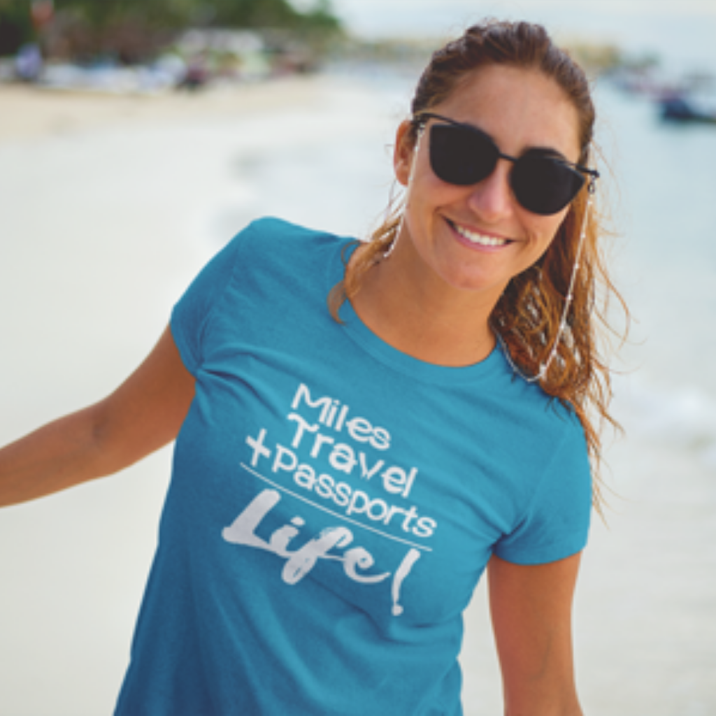 woman in travel is life passport shirt